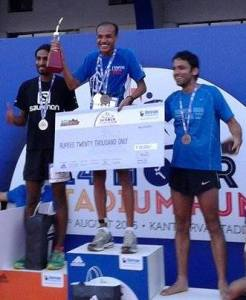 Abbas Sheikh on the podium after winning the stadium run in Bengaluru, August 2015.