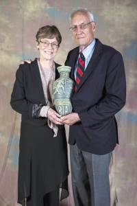 Judy and John Collins, at their induction into the USA Triathlon Hall of Fame in 2014. Triathletes from California, they introduced the triathlon to Hawaii on February 18, 1978 by creating and staging the first endurance tyriathlon, The Hawaii Ironman Triathlon, a swim/bike/run course that circled the island of Oahu. The Ironman course linked the minimum 2.4mile Waikiki Roughwater Swim, an estimated 112 miles of the 115 mile Round Oahu Bike Course and the 26.2 mile Honolulu Marathon (Photo: courtesy Judy and John Collins)