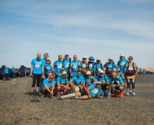 Girish (fourth from right, back row) with his German and Austrian tent mates at the Marathon des Sables. The blue UNICEF T-shirts is for the last day's charity run (Photo: courtesy Girish Mallya)