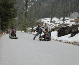 Youngsters with improvised summer luges on the hill slopes near Manali (Photo: courtesy Shiva Keshavan)