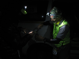 August 11th night. En route to Khardung La, Mark Woolley gets a quick refill of water from one of the support vehicles (Photo: Shyam G Menon)