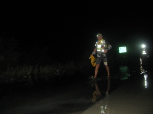 Night of August 11; Grant Maughan crossing the waterlogged stretch of road (Photo: Shyam G Menon)