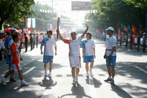 Meena with the Olympic torch; from the torch relay head of the Beijing Olympics