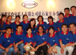 Meena with her team at the China office of Shalina Healthcare