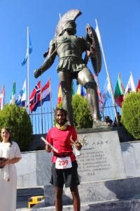 The formal finish at Spartathlon at the foot of the statue of King Leonidas (Photo: Sparta Photography Club / courtesy: Kieren D'Souza)